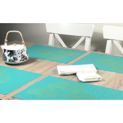 Teapot in view of all four vibrant green Verdigris woven vinyl tablemats