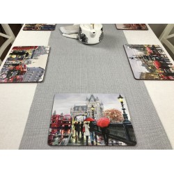 Wide view of Streets of London corkbacked placemats on grey runner
