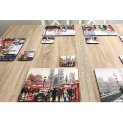 Wooden dining table with Streets of London corkbacked placemats by Plymouth Pottery