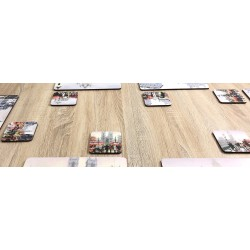 Close up of Streets of London corkbacked coasters on wooden dining table