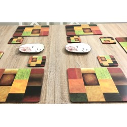 Close up of Majestic design of vibrantly coloured corkbacked placemats on wooden dining table by Plymouth Pottery
