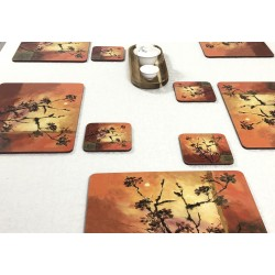Sunset design corkbacked tablemats. Each place mat is shown against white tablecloth