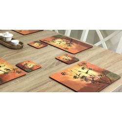 Stylish set of Sunset design square drinks coasters. Shown against wooden dining table