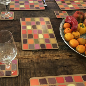 Harlequin colourful modern placemats on a vintage wooden table
