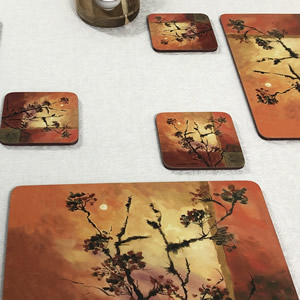 Sunset placemats on white tablecloth
