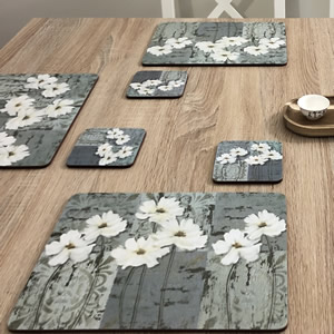 White Poppies placemats and coasters set on wooden table